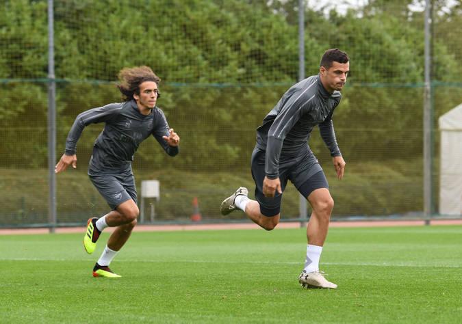 Xhaka and Guendouzi in training