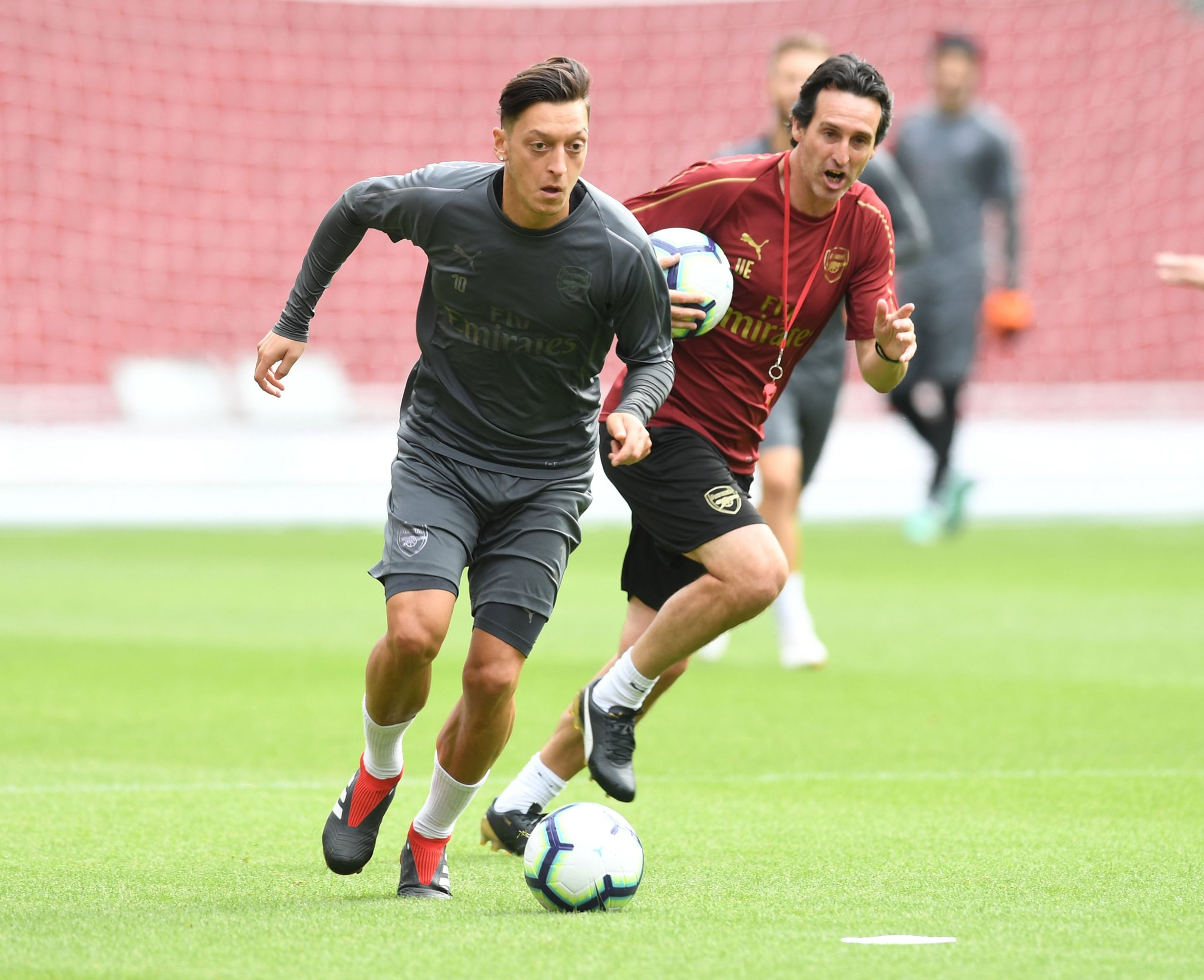 Mesut Ozil and Unai Emery